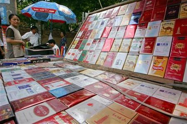 Macau government cuts duty-free cigarette allowance by half to 100