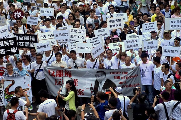 Protest against 'golden handshake' bill draws record crowd
