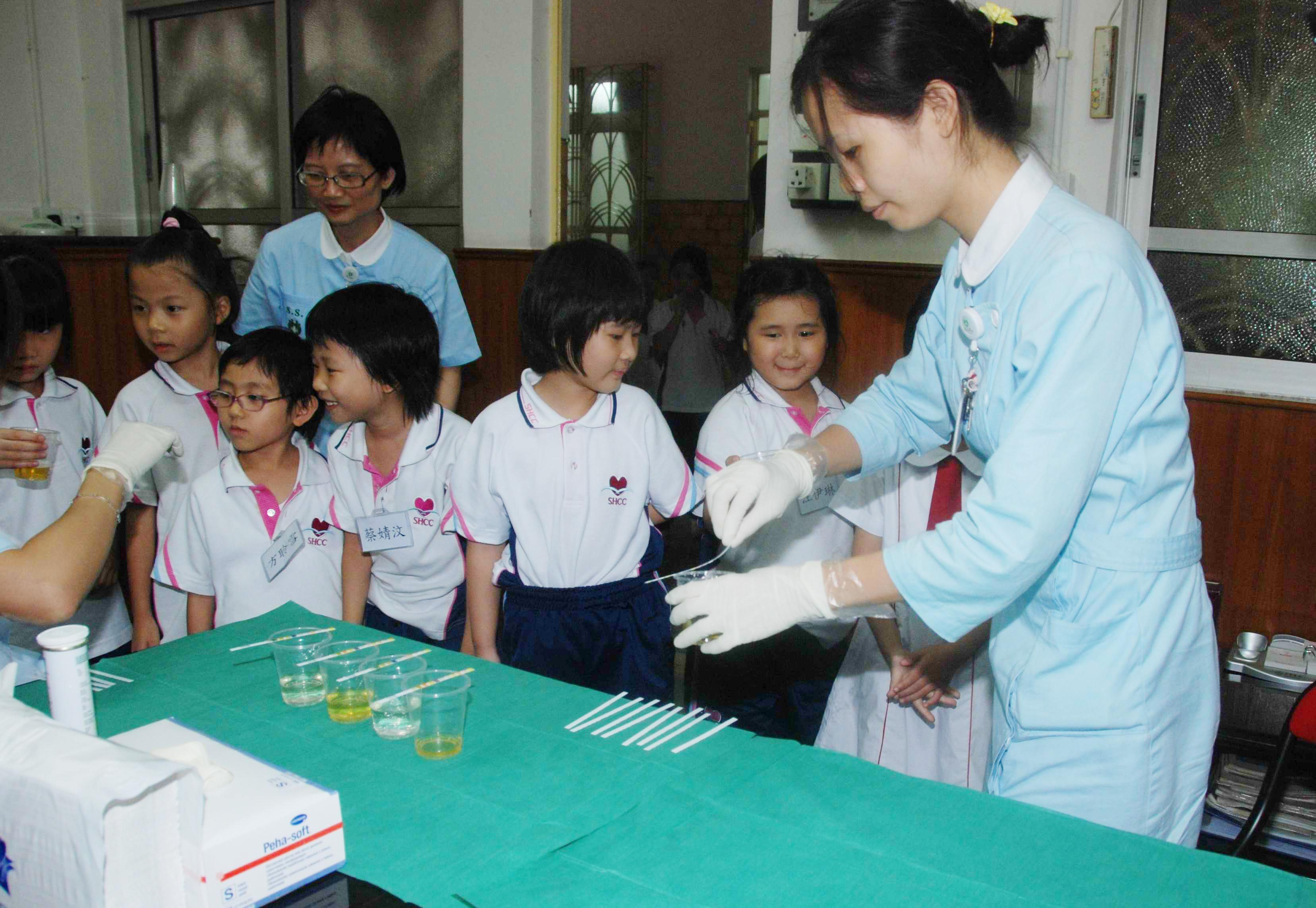 Macau says no kidney problems found in students tested after drinking milk products