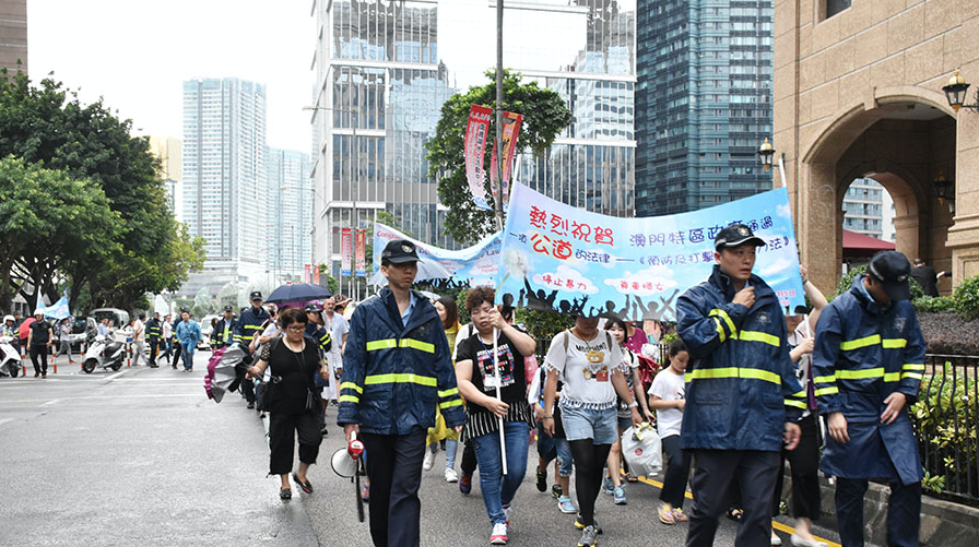About 70 march in Macau to celebrate domestic violence law