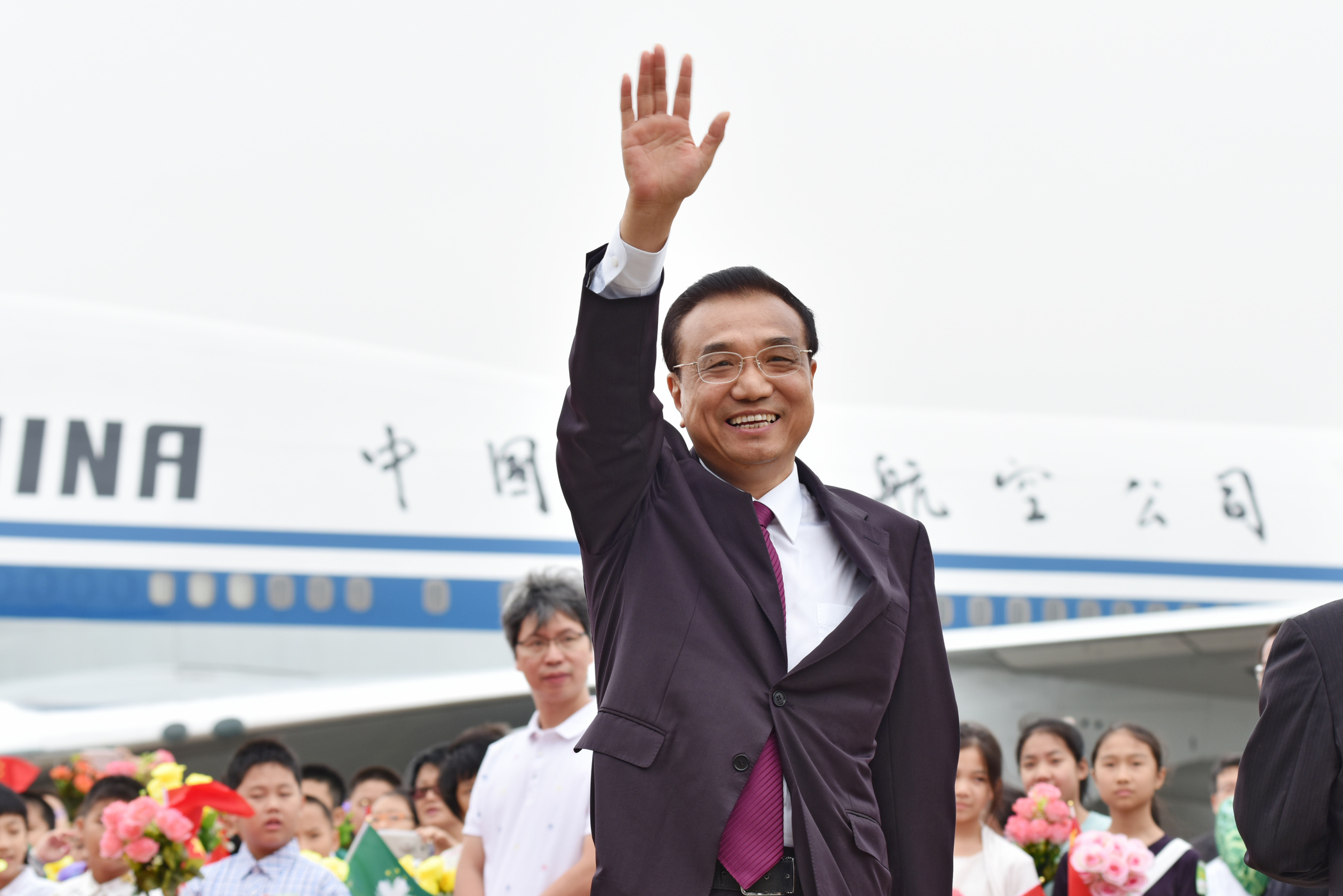 Li pushes for diversification in Macau and vows to return