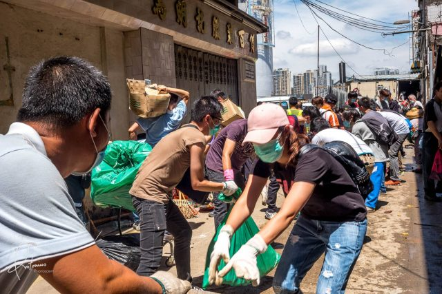 Volunteers cleaning up the city in the aftermath of Typhoon Hato
