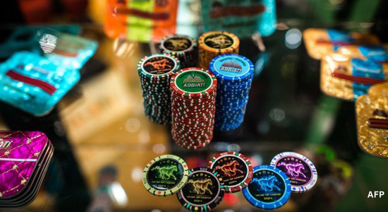 Macau police hunt for HK$48 million in gambling chips after casino robbery