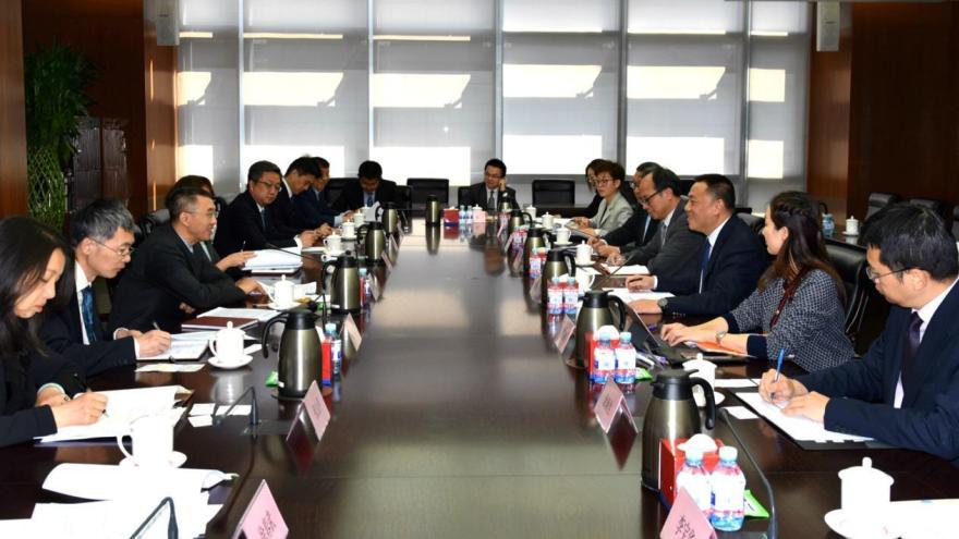 Leong Vai Tac discusses Macau's role as a financial platform, in Beijing