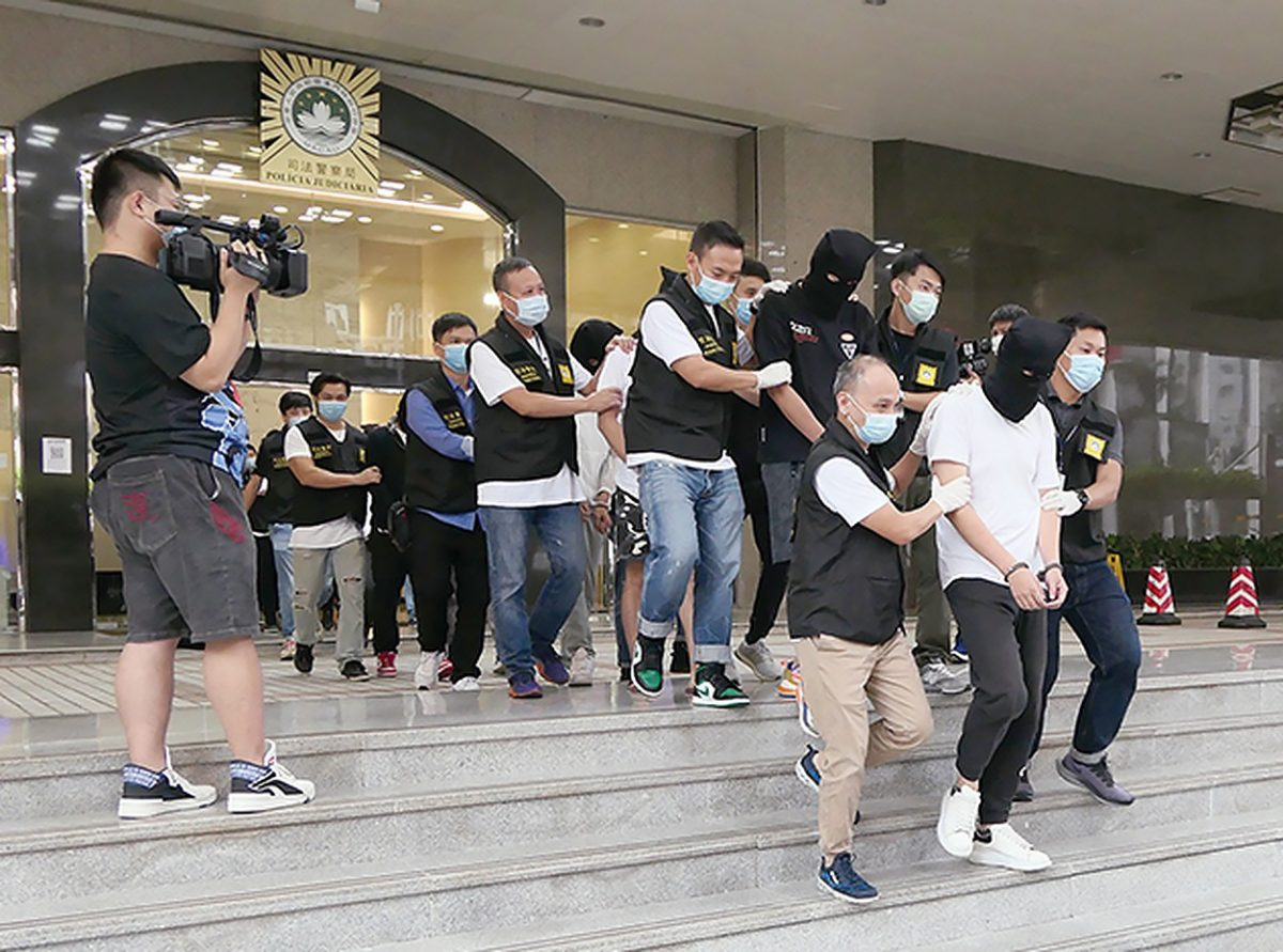 9 men nabbed for cheating bank out of HK$900,000 for bogus car loans