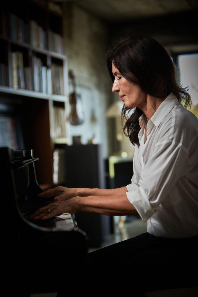 Galina Bessmertny plays on her piano