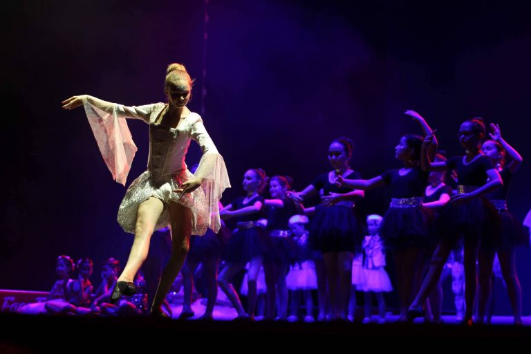 A dancer performs in front of the cast at the club's 'Made in Macau- Rock Thru the Ages' show in June 2018 at The Parisian Macao Theatre - Photo Courtesy of Macau Glee Club