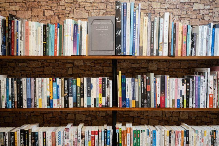 Filled bookshelves inside Slow Tune Book Shop | Photo by Denzel Calangi