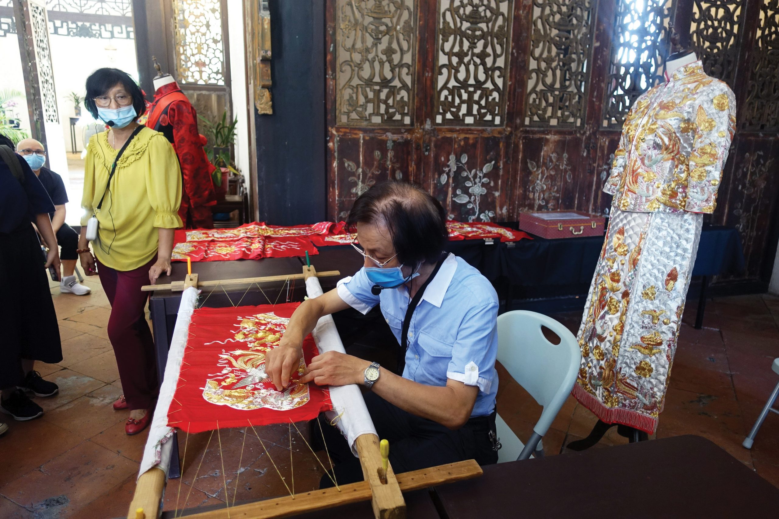 Making of Chinese wedding dresses - Photo courtesy of the Cultural Affairs Bureau
