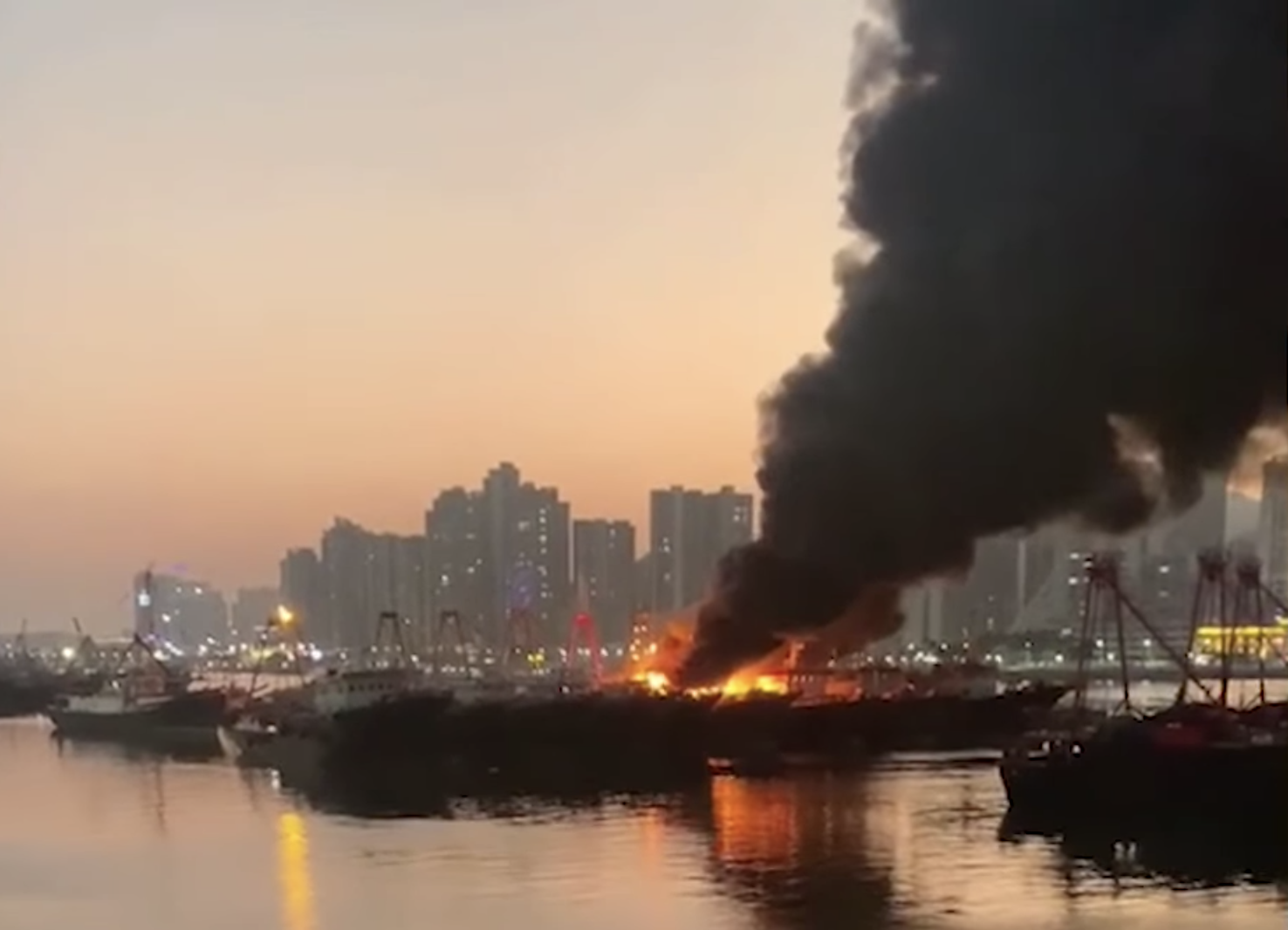 Three fishing boats engulfed in harbour blaze