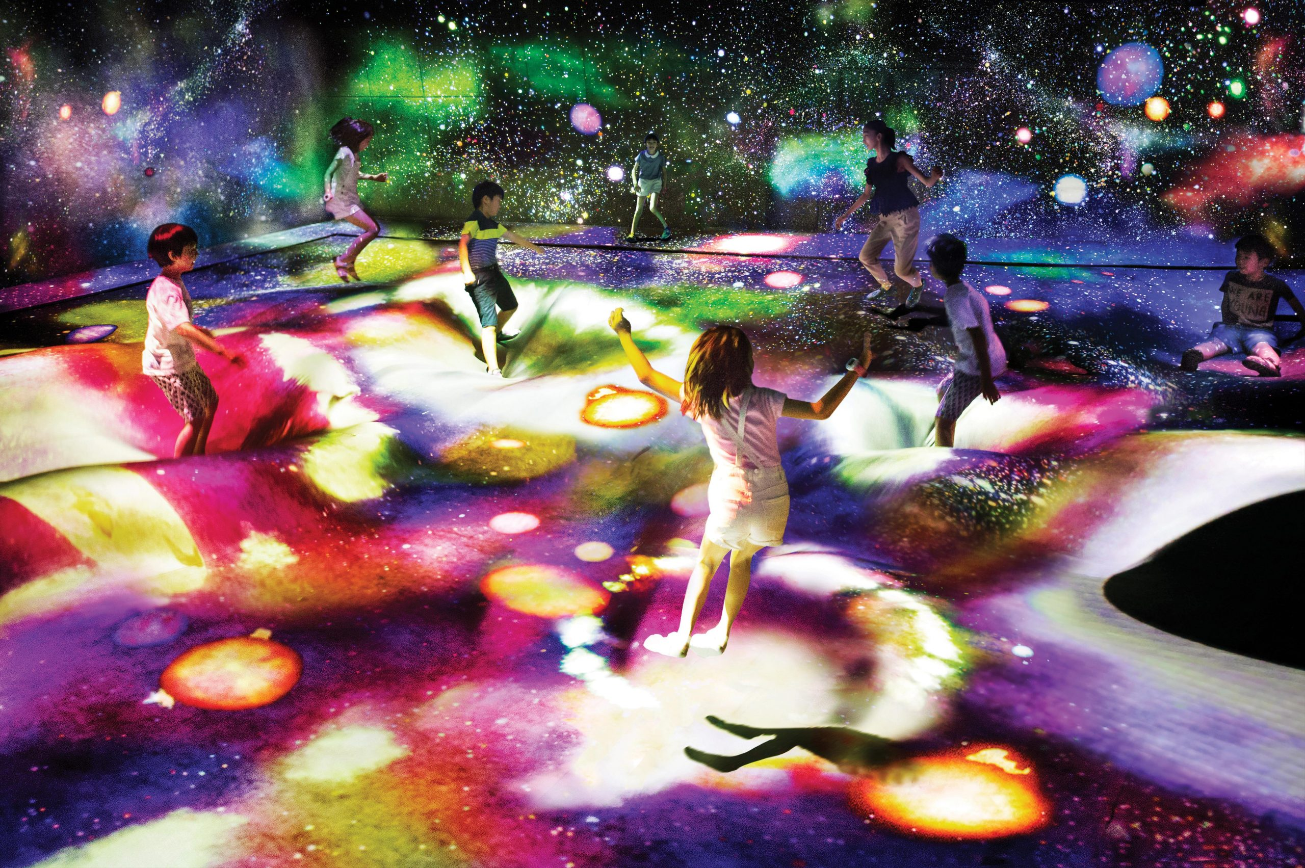 The teamLab exhibition's 'Multi Jumping Universe' section offers visitors an interactive experience under the stars. You can jump' or 'sink' with other visitors as new stars are born when the installation's surface becomes distorted - Photo by teamLab