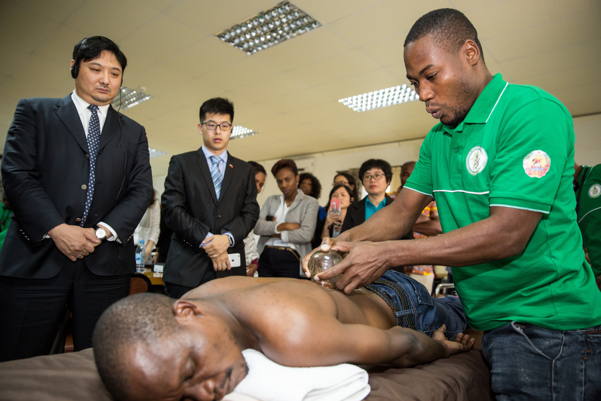 Mozambique student learning cupping during a TCM training course