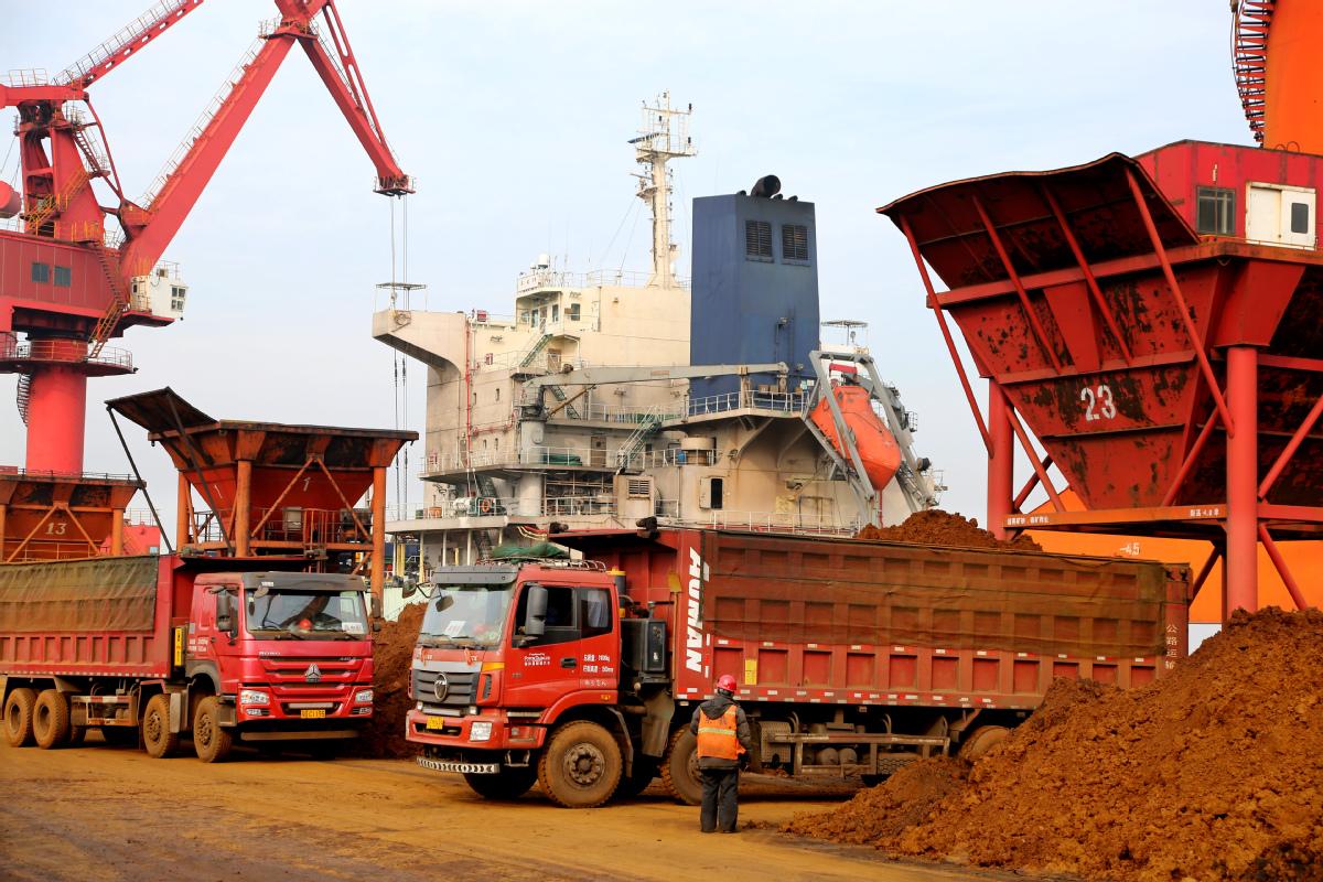Imported iron ore is unloaded at Lianyungang Port, Jiangsu province