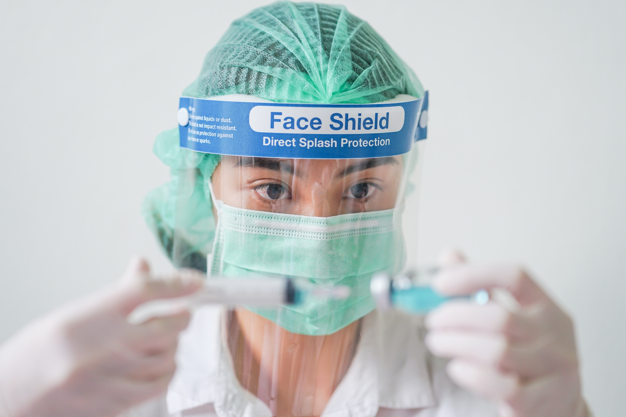 Medical worker with vaccine