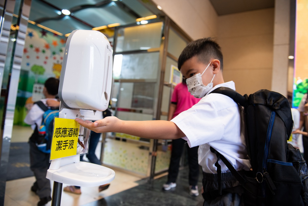 Student wearing mask going to school